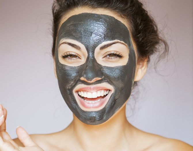 woman with black mask on holly wood peel